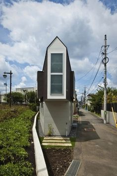 This Tokyo house is the work of design firm Mizuishi Architect Atelier. Housed on a lot of about 312 square feet, this three-cornered abode includes a deck, a loft play area, as well as a full bedroom, bath and office