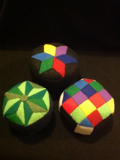 Three of my felt geometric patterned pin cushions