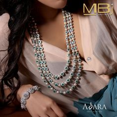 Diamond necklace with emerald & pearl along with diamond bracelet from Adara collection of MBj.