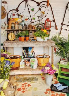 Love the old wrought iron on the wall great potting bench