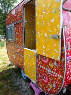 Caravan with wallpaper on outside