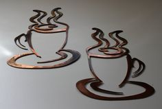 Coffee Cups set of 2 copper and bronze plated metal wall art decor. $17.95, via Etsy.