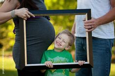 Big Brother looking forward to his new sibling being born - looking through a photo frame