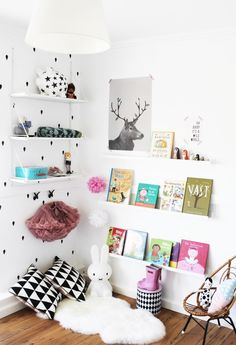 all white kids room reading nook