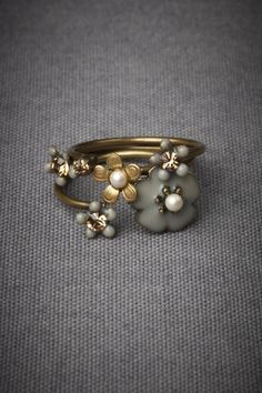 Autumnal Stacking Rings - BHLDN by Eric et Lydie Love all of their stacking rings- and these are adjustable!