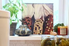 Fall_Blogger_home_tour_living_room_neutral_decor_autumn_colors_meme_hill_Amie_freling_HomeGoods_agape_candle_canning_pickles_corn_art_gourd