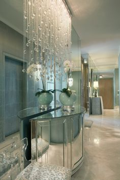 Im not so much for the mirrored walls, the fingerprints alone would drive me batty, but the crystal light?  I am all over that.