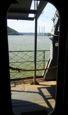 A view of the Clifty Creek power plant here in Madison,IN from a port-side hatch of the visiting WWII ship LST 325.