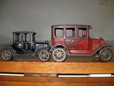 1920s cast iron toy cars chose this because it shows the different styles of cars in the 1920s