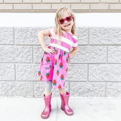 On Mondays we wear Strawberries 🍓 This picture pretty much sums up this kid. Her new dress, her favorite color, her favorite accessories and her favorite pose.