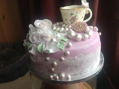 A Vintage Birthday cake...everything on the cake is edible. Even the cup..
