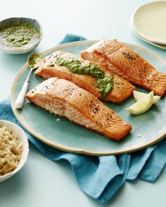Pan Seared Salmon with an Herb Pesto Vinaigrette Recipe, I love the simple colors, the way the salmon looks on the sea green plate, the composition, the use of the napkin underneath, and the backlighting. Nice shot!