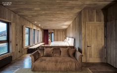 A custom sofa upholstered in cotton velvet appoints a cabin. Photography by Fernando Alda.