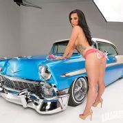 Lowrider cars and porn stars, clothed then nude female