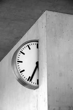 "Part-time, photo by Eke Miedaner. From the comments: ""Shy clock?"" ""The clock is two-faced, so you have to take a look on both sides to know the time."" (This is an official school-clock in KV Baden-Zurzach). Inspire Me Home Decor, Beton Design, Concrete Design, Decoration, Signage, Design Inspiration, House Design, Wall Design, Black And White"