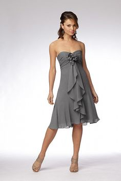 Stone crinkle chiffon strapless above the knee length dress with shirred bodice, cascading drape and chiffon flower at empire