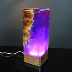 The piece is created using wood, transparent resin and silver dust. The resin has glass like properties and is mixed with various pigments to achieve the effect of dancing colors. The silver dust swirls inside and shines beautifully in light, mimicking the dancing stars of the night sky.