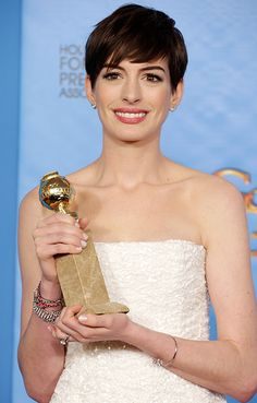 "Hathaway thanked the Hollywood Foreign Press Association ""for this lovely blunt object, that I will forever use as a weapon against my self-doubt."" at the 70th Annual Golden Globe Awards."