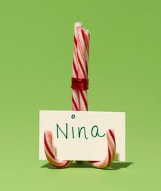 Candy Canes as Place Card Holder | told @Sherise Adkins Henderson to pin this and still thought it said NINJA when it popped up in my feed later...