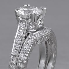 double prong edwardian engagement band with curved accompanying wedding band. LOVE