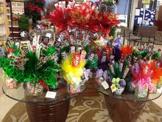 Candy bouquet - fun idea for a gift. Fill a vase with bite-sized candies. Glue full-sized candy bars to small dowel rods and insert. Add ribbons, bows, tulle, or cellophane. Ta-da :)