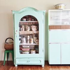 once again dottie angel has such a lovely hand in things...the most perfect aquaey, robin's egg bluey kinda color for this absolutely fantastically charming little hutch...