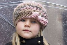 Puff Stitch Hat with Bow by Mon Petit Four -pattern in a size to suit a toddler (Size 3-4). It can be easily adapted for any size by simply adjusting the crown width & height.
