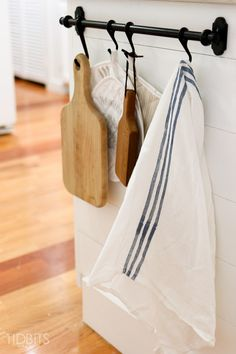 Hang a rod on the peninsula for a quick reach to cutting boards and hand towels. Hang a rod on the peninsula for a quick reach to cutting boards and hand towels. Kitchen Pantry, New Kitchen, Kitchen Storage, Kitchen Decor, Kitchen Ideas, Pantry Cupboard, Kitchen Counter Organizing, Kitchen Island Towel Bar, Kitchen Cabinets