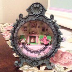 1:144 scale miniature scene inside clock casing by Sheila A. Nielson