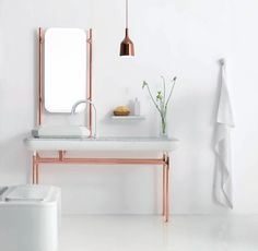 The Hayon Bath Collection, designed in collaboration with Spanish designer Jaime Hayon. The collection recalls the glamour of the 1930s with a Scandinavian touch and feminine shapes. We particularly like the unexpected polished copper-plated aluminum frame for the Carrara marble sink.