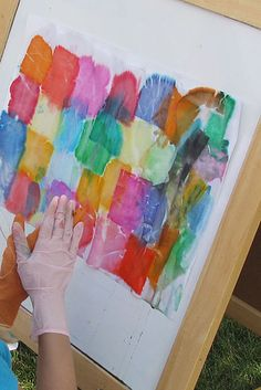 Use tissue paper to create art. | Spray the tissue paper with water and it'll stick to the paper. Once you peel it off, the color stays on the paper!