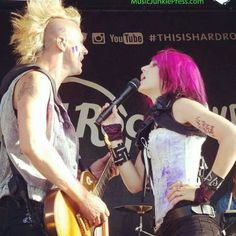 Ariel Bloomer - Icon for Hire White corset over black sleeveless blouse? I like.
