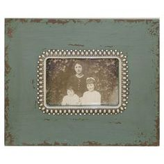 "Distressed turquoise wood picture frame.    Product: Picture frameConstruction Material: WoodColor: TurquoiseFeatures:  Pearl accentsHolds one 3"" x 5"" photo  Dimensions:  8.5"" H x 9.5"" W"