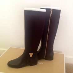 Micheal Kors dark chocolate tall boots Micheal Kors dark chocolate tall boots. Has gold tone hardware MK lock and gold zipper. Boots are leather and fabric. ⚠no tradesplease don't ask what's lowest price make an offer using the make a offer button. Prices will not be negotiated in the comment section. Happy Poshing. Michael Kors Shoes