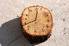 Natural Playground: Sundial. All you need is a log slice, nail, and a sharpie.