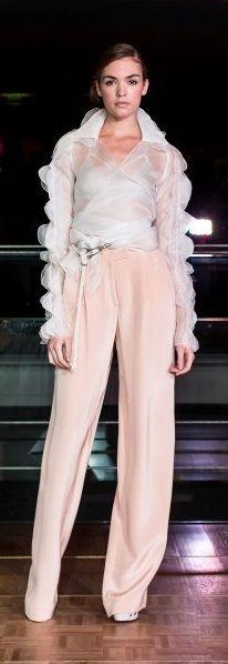Éric Tibusch ~  like the feminine ruffled flouncy, blouse.