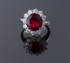 Oval Red Spinel and Diamond Ring  Platinum (17 x 16mm)  S=4.42cts app + D=1.44cts app  $75,000
