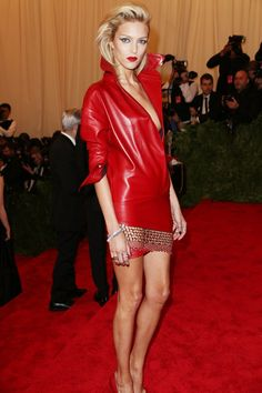 Anja Rubik arrived at the Met Gala in a red leather Anthony Vaccarello dress with chainmail skirt.