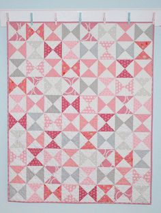 So pretty in pink and gray! What a wonderful Hourglass Baby quilt by Tessa Marie from The Sewing Chick. Tessa Marie used a combination of many fabrics including Moda Fabrics United Notions, Art Gallery Fabrics, ( scrappy is always fun) and pieced with #Aurifil 50wt thread. To see more please visit http://thesewingchick.com/2015/07/hourglass-baby-quilt-a-finished-quilt.html/