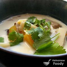 Pumpkin Braised in Coconut Milk (Canh Bi Ro Ham Dua) is a traditional Buddhist vegetarian dish finished with raw peanuts and a sprinkling of fresh herbs.