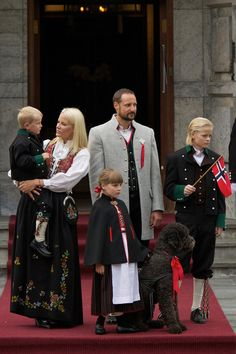Prince Sverre Magnus of Norway, Princess Mette-Marit of Norway, Princess Ingrid Alexandra of Norway, Crown Prince Haakon of Norway and Marius Borg Hoiby attend The Childrens Parade with their labradoodle Milly Kakao on May 17, 2011 in Asker, Norway.