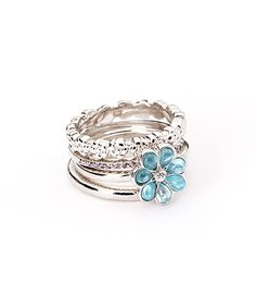 Look what I found on #zulily! Rhodium & Blue Cubic Zirconia Flower Stackable Ring Set by SHABLIS #zulilyfinds