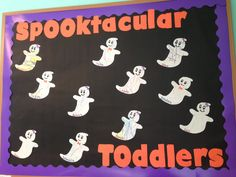 Toddler Halloween bulletin board. Colored white paper then cut out ghosts. Boys got bowties, girls got hair bows and eyelashes : )