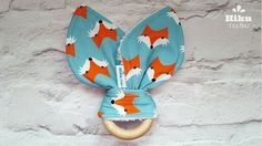 Ash tree wood teething ring with fabric bunny ears in trendy fox print. Great organic and safe alternative to plastic teethers!  About Hiku Teethers: