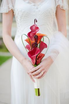 Beautiful DIY bridal/bridesmaid bouquet. Fantastic use of color to contrast the white dress/decorations. Great example of what a little creativity and a few flowers can do!