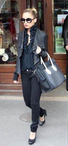 Who made Nicole Richie's skinny jeans, purse, black pumps, sunglasses and bag that she wore in Paris on March 5, 2011? Sunglasses – Chanel  Shoes – Balenciaga  Purse – Celine  Jeans – JET