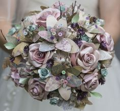 What a stunning paper bouquet from our Approved Supplier Sarah's vintage ephemera bouquet. Gorgeous soft pastel mix created from pages of vintage French lifestyle magazines buttons & more Gorgeous image by Paper Flowers Wedding, Paper Flowers Diy, Paper Roses, Bridal Flowers, Wedding Paper, Book Flowers, Pastel Flowers, Bridal Bouquets, Origami Flower Bouquet