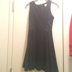 Fit & flare dress Fit and flare black dress with faux leather embellishments. Only worn once. Perfect for NYE! Dry cleaned for purchase. Love Addy Dresses Mini