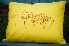 "Embroidered hand-print ""hug"" pillow.  Good grandparent/child or OT prop."
