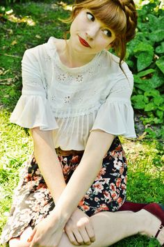 white boho top with ruffle flared sleeves over floral skirt. top braid is super cute!